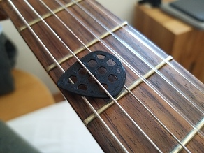 Guitar pick with hex-cutouts