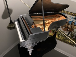 Grand piano with moving parts