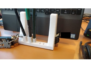 Notebook stand with pen, usb and sd card holder