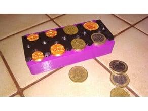 Distributeur de monnaies automatique