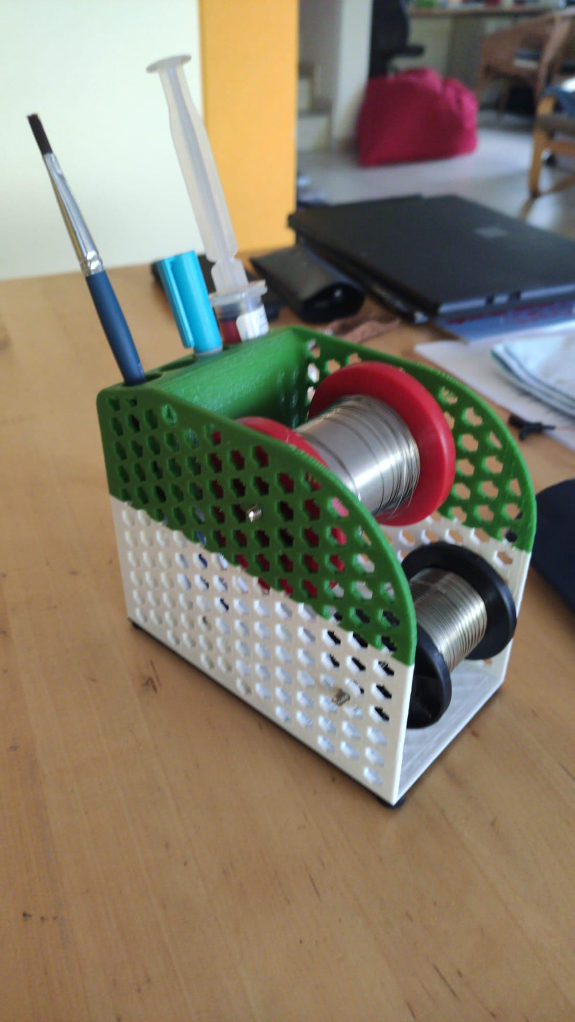 Holder for solder roll and flux