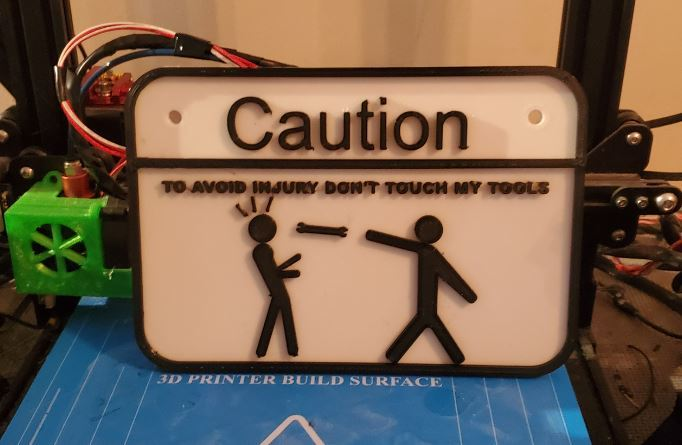 Caution - To Avoid Injury Don't Touch My Tools