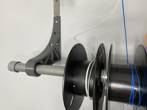 Wall-mounted clothing rod / spool bracket