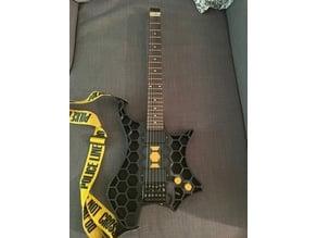 Steel core headless electric guitar