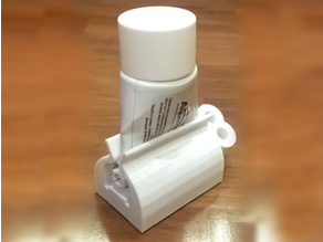 Toothpaste squeeze holder
