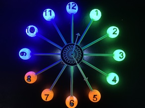 Wall clock with LEDs and kinetic sculpture