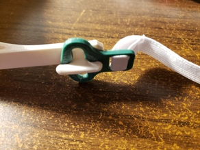 adjustable clip to connect elastic to the NIH approved face shield