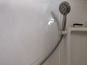 Handheld shower head holder