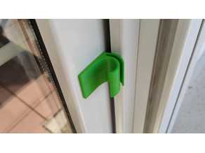 """keep closed"" balcony door handle"