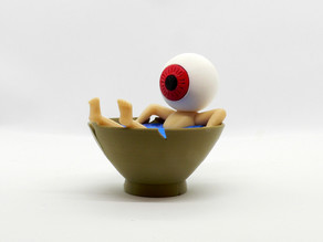 Eyeball Father in a teacup