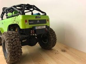 Deadbolt rear bumper and sign plate
