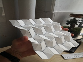 Rigid foldable origami with flexible joints