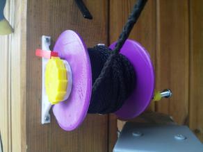 Manual reel with brake