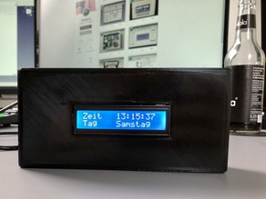 Arduino digital clock case with time, day, date and temperature