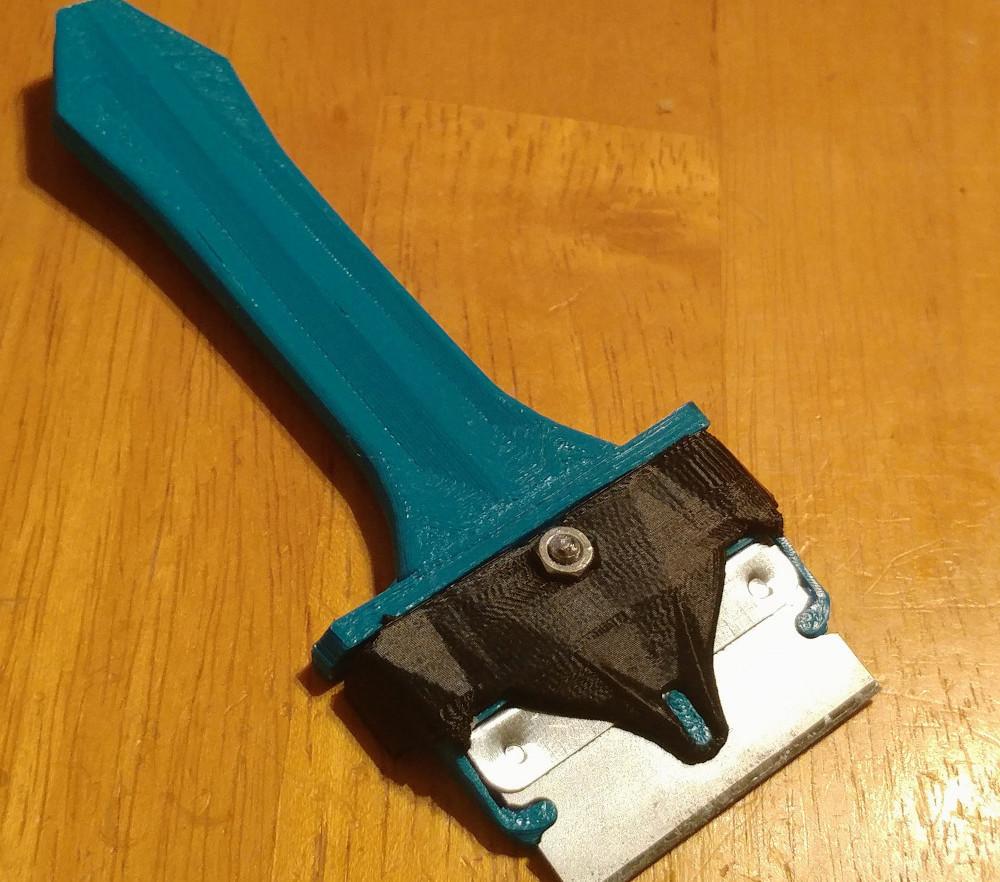 Single-edge razor scraper