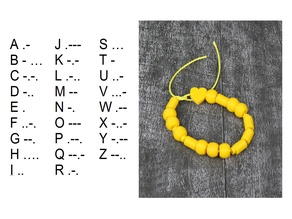 What is your message to the World? - Morse code bracelet - try to read message at photo