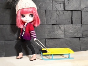 Sled for a doll