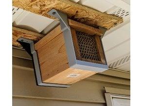 Mason bee house mounting bracket to hand under eaves