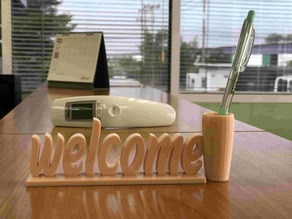 welcome sign with penholder