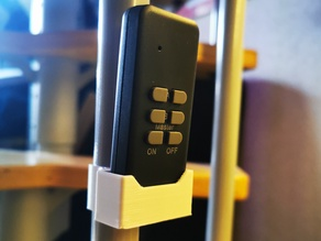 remote holder for round vertical handrail