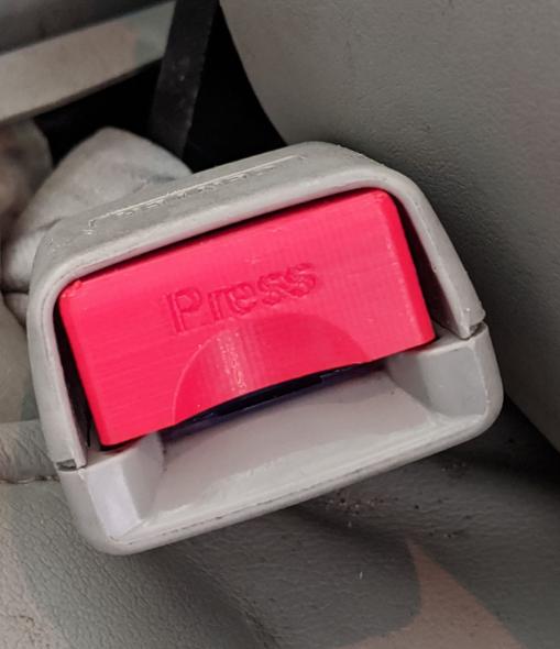 Mazda seatbelt release button
