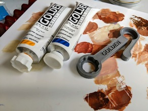 Golden Wrench for opening acrylic paint tubes