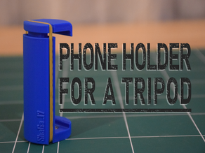 Phone holder attachment for a tripod