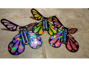 Surprise butterfly rubber band powered prank toy
