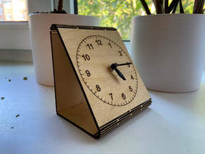 Table clock with living hinge using laser cutting