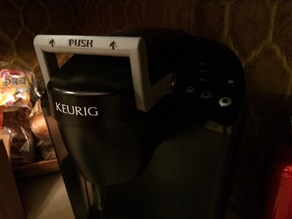 Keurig handle fits under the cabinets when opened