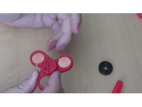 3D printed penny spinner with built in bearing