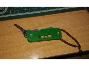 Pocket key holder with bottle opener