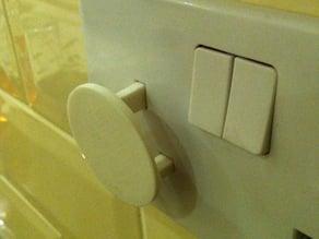 UK mains socket safety cover