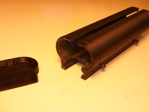 Battery case with picatinny rail