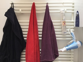 Hook for towel radiators