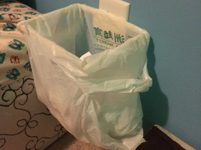 Power outlet grocery bag trash can