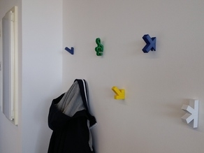 Interchangeable wall coat hook