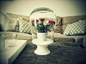 Flower pedestal with glass dome