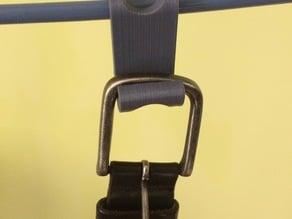 Clip-on belt holder for coat hanger