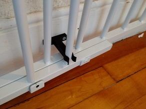 Clip for swinging baby gate