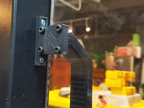 Magnetic bracket for doors and enclosures