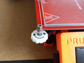 Prusa i3 bed adjuster with a direction arrow.