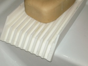 Soap holder with water drain