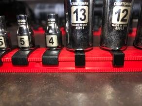 Socket tray slot sliders