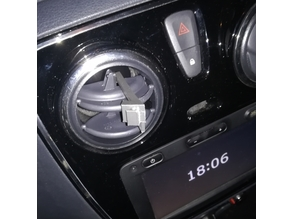 Phone holder clip on ventilation flap of a Dacia Lodgy car