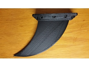 Skeg fin for Deflecting Debris around a hull mounted Bluerobotics T100 or T200 Thruster