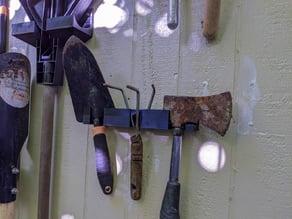 garden tools hangers: shovel, rake, axe, broom, hand tools
