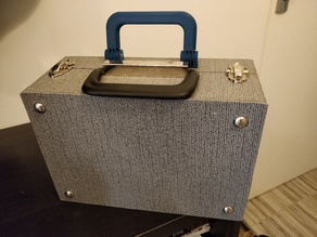 Hinged carry handle