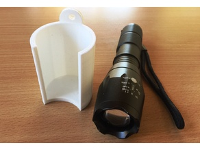 Wallmount holder for flashlight