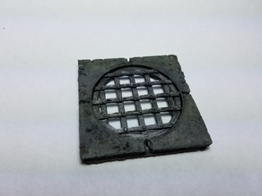 Circular Sewer Grate and Stone Tile